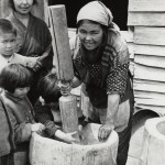 Ainu-Japanese woman pounding with motar and pestle